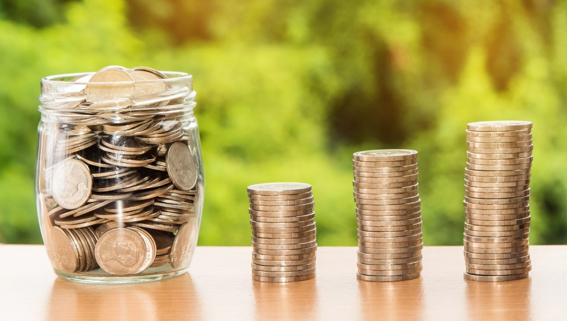 Canva - Piled Coins and Coins in a Jar